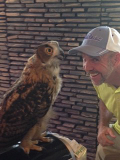 Mike Dillon, owner of Critter Ridder in Texas, with an owl.
